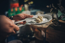 Cropped Hands Serving Food In Plate