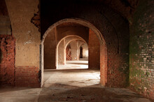 Perspective View Of Dark Tunnel With An Arched Brick Ceiling In Old Abandoned