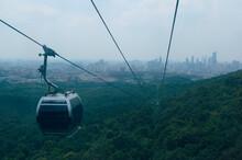 Overhead Cable Car Over City Against Sky