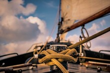 Close-up Of Sailboat Against Sky