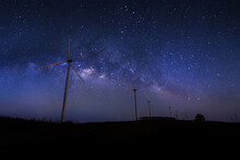 Scenic View Of Silhouette Wind Turbines Against Sky At Night