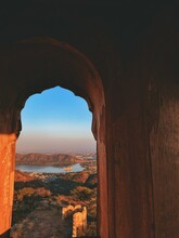 View Of Rock Formation Against Sky In Jaipur ,world Heritage City . Jal Mahal Is Also Visible .