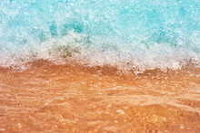 Sea Wave On The Sand Beach, Soft Focus. Summer Background. Waves With Splashes And Foam.