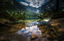 Scenic View Of Lake With Reflection Against Mountain