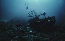 Scuba Diver And Shipwreck Underwater