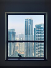 Pigeon Bird Sit On Window With Dubai Marina Skyscrapers View