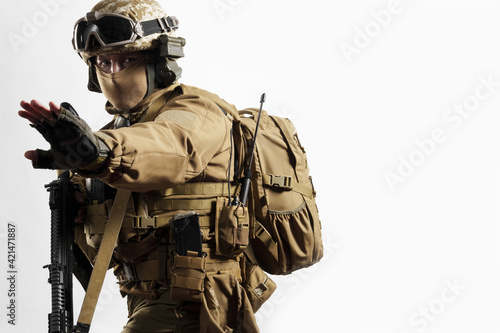 Obraz na plátně Male soldier in tactical equipment and uniform (coyote brown color)