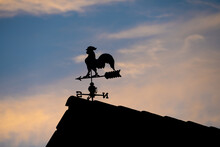 Low Angle View Of Silhouette Weathercock On Roof