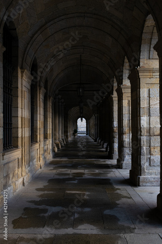 Canvas Print Tunnel of stone arches in the streets of Santiago de Compostela.