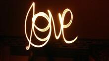 Close-up Of Illuminated Love Text