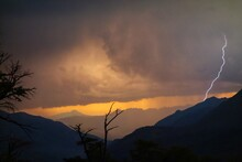 Silhouette Of Mountain Against Dramatic Sky During Sunset