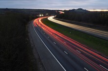 High Angle View Of Light Trails On Road At Dusk