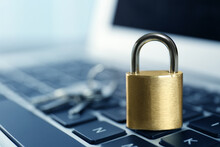 Metal Padlock On Laptop Keyboard, Space For Text. Cyber Security Concept