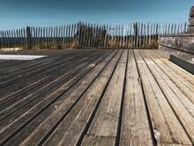Wooden Boardwalk Against Sky