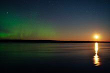 Northern Lights And Rising Moon Reflected In A Canadian River