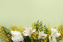 Beautiful Floral Composition With Mimosa Flowers On Green Background, Flat Lay. Space For Text