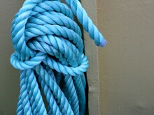Coil Of Light Blue Rope Against Grey Background