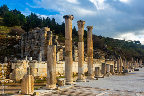 Canvas View of remains of State Agora colonnade on background of small Odeon used as bo