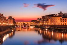 Ponte Vecchio Shot Against A Vibrant Sky Shortly After Sunset