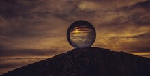 Low Angle View Of Crystal Ball Against Sky During Sunset