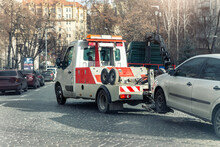 Car Evacuation Police Service By Tow Truck Machine On City Downtown Street Center Due Parking Traffic Rules Violation. Emergency Road Assistance Service Motorway. Automotive Trailer Carrier Transport