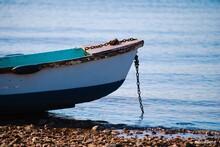 Fishing Boat On Sea Shore Against Sky