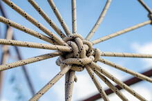 Close-up Of Ropes Tied Against Sky