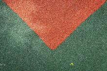 High Angle View Of Arrow Symbol On Grass