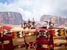 Vintage Kettles And Carpets Against Mountains