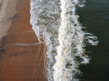 Close-up Of Water Flowing At Beach
