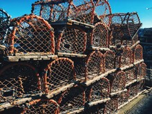 Close-up Of Lobster Pots Against Sky