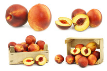 Fresh Nectarines And Some In A Wooden Crate On A White Background
