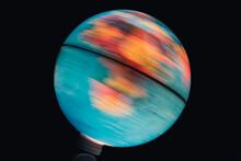 Illuminated World Globe Spinning With Black Background