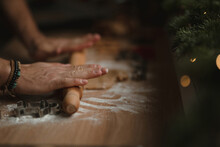 Closeup Of Man Hands Making Gingerbread From Dough At Home