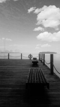 Empty Bench On Pier Against Sky