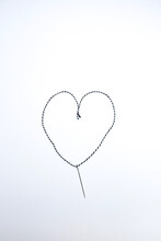 High Angle View Of A Pin With S Heart Shaped Thread. Diy Project.