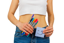 Slim Body In Blue Jeans With Colored Felt Tip Pens In The Hand