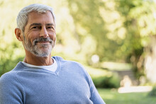 Portrait Of Smiling Mature Man In Backyard