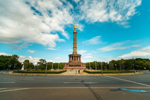 Low Angle View Of Berlin Victory Column Against Cloudy Sky