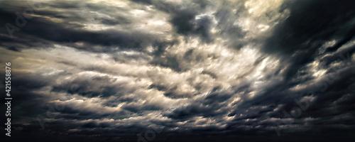 Fototapeta Dramatic dark stormy sky with rain clouds as background obraz