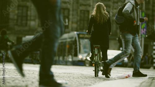 Obraz Rear View Of People Walking On Street In City - fototapety do salonu