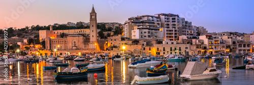 Billede på lærred Fisherman and passenger boats in Marsaskala bay in Malta