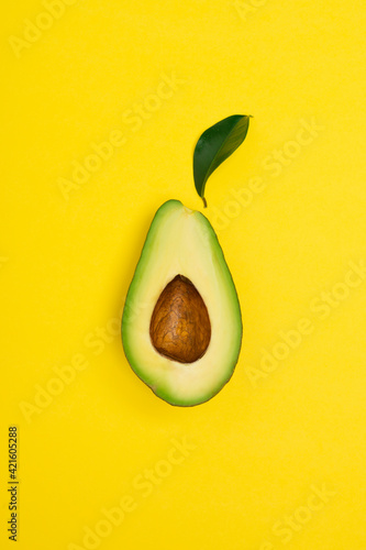 Fotografia, Obraz Ripe avocado on yellow background