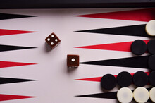 View From The Top To The Playing Field In Backgammon With Chips And Dice Brown. Play A Board Game. High Quality Photo
