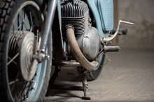 Old Garage Concept Background. Retro Style Dusty Motorcycle In The Workshop.