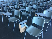 High Angle View Of Empty Chairs In Classroom