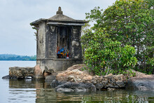 An Old Buddha Shrine On A Tiny Island In A Lake