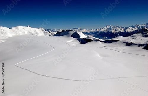 Fototapeta Scenic View Of Snowcapped Mountains Against Clear Blue Sky