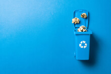 Trash Bin. Blue Dustbin For Recycle Paper Trash Isolated On Blue Background. Container For Disposal Garbage Waste And Save Environment.