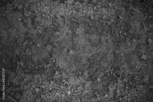 Fototapeta Dried cracked earth soil ground texture background. Mosaic pattern of sunny dried earth soil obraz